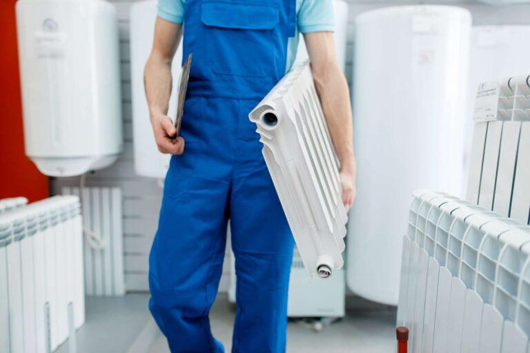 parkair plumber holds heating radiator plumbering store 6E9N9NR