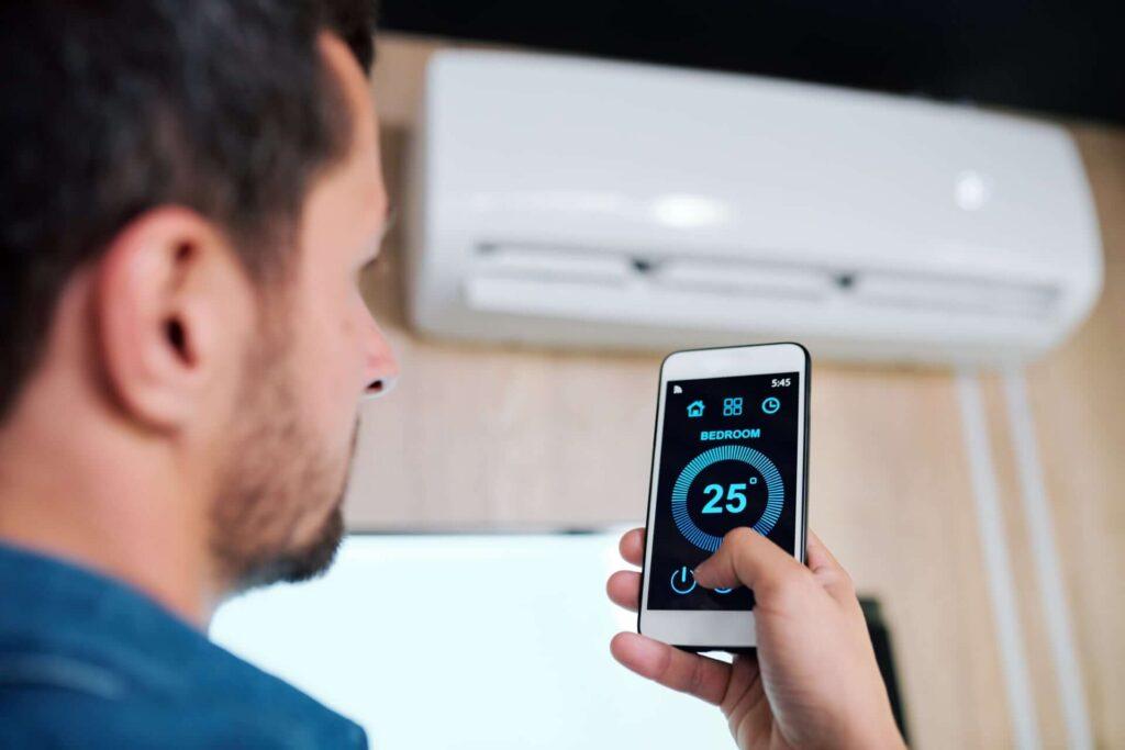 parkair young man using smart application to adjust temper 3QUT76L